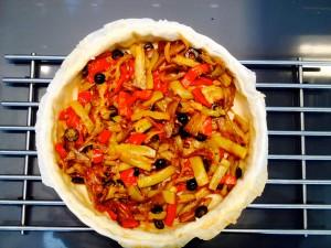 versez les légumes au fond de la tarte